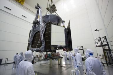 Technicians use an overhead crane to lower NASA's Juno spacecraft onto a fueling stand where the spacecraft will be loaded with the propellant necessary for its mission to Jupiter.