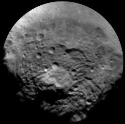 This enhanced image, taken by the framing camera instrument aboard NASA's Dawn spacecraft on July 9, 2011, views the south polar region of this giant asteroid.