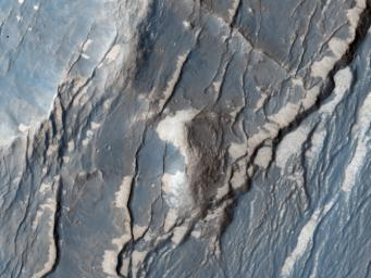 NASA's Mars Reconnaissance Orbiter captured this image of the Claritas Fossae region, characterized by systems of 'graben.' A graben forms when a block of the planet's crust drops down between two faults, due to extension, or pulling, of the crust.