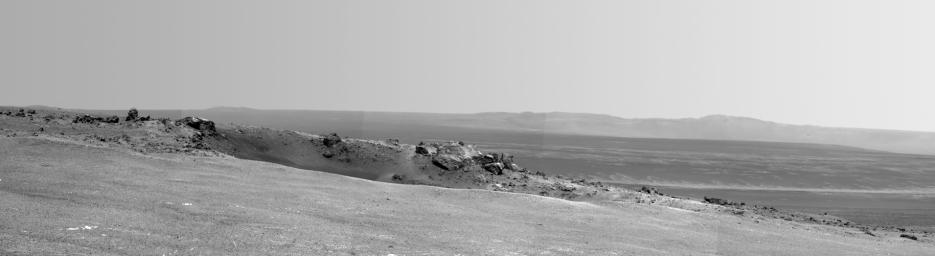 This scene captured by NASA's Mars Exploration Rover Opportunity shows the 'Spirit Point' area of the rim, including a small crater, 'Odyssey' on the rim, and the interior of Endeavour beyond.