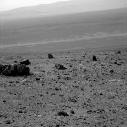 The large rock on the left in the foreground, informally named 'Tisdale 1.' It is part of a group of rocks that appear to have been ejected by the excavation of Odyssey crater on the rim of Endeavour crater by NASA's Mars rover Odyssey.