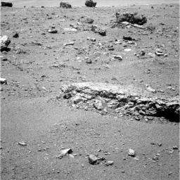 The flat-topped rock, informally named 'Tisdale 2,' just below the center of this raw image from the rover Opportunity's panoramic camera was chosen by the rover team in August 2011 as a stop for inspecting with tools on Opportunity's robotic arm.