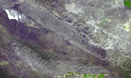 This image acquired by NASA's Terra spacecraft shows the Carrizo Plain, located northwest of Los Angeles, CA. It is one of the easiest places to see surface fractures of the San Andreas Fault, evident as it crosses the image from lower right to upper left