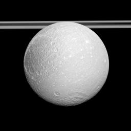 NASA's Cassini spacecraft examines the anti-Saturnian side of Dione and shows the cratered surface east of the moon's distinctive wispy terrain which consists of bright cliffs on the moon's trailing hemisphere.