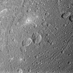 Ejected material appears bright around some of Dione's craters in the image taken during NASA's Cassini spacecraft's flyby of the moon on March 28, 2012.