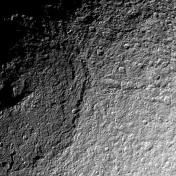 NASA's Cassini spacecraft takes a detailed look at the northern part of the huge Odysseus Crater on Saturn's moon Tethys. The crater dominates the left half of this view of Tethys.