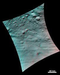 This 3D image shows the topography of Vesta's densely cratered terrain obtained by the framing camera instrument aboard NASA's Dawn spacecraft on August 6, 2011. You need 3D glasses to view this image.