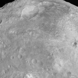 NASA's Dawn spacecraft obtained this image of craters with bright features on asteroid Vesta with its framing camera on August 18, 2011. The image has a resolution of about 260 meters per pixel.
