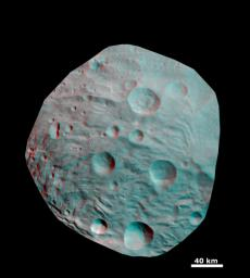 This 3D image shows the topography of craters and grooves of asteroid Vesta's south polar region obtained by the framing camera instrument aboard NASA's Dawn spacecraft on Aug. 23 and 28, 2011. You need 3D glasses to view this image.