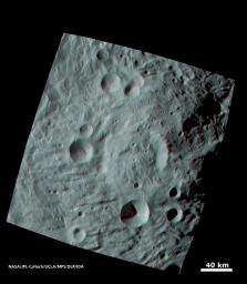 When NASA's Dawn spacecraft sent the first images of the giant asteroid Vesta to the ground, scientists were fascinated by an enormous mound inside a big circular depression at the south pole. You need 3D glasses to view this image.