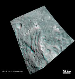 In this image, obtained by NASA's Dawn spacecraft from above the surface of the giant asteroid Vesta, topography in the area surrounding the south pole area shows impact craters, ridges and grooves. You need 3D glasses to view this image.