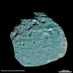 This image of the giant asteroid Vesta obtained by NASA's Dawn spacecraft shows numerous impact craters illustrate the asteroid's violent youth. You need 3D glasses to view this image.