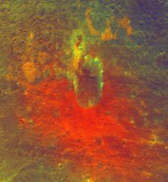 This false-color image obtained by NASA's Dawn spacecraft shows a crater on the giant asteroid Vesta. The reddish coloring below the crater points to material that was hurled from Vesta's interior during an impact or originated from the impactor itself.