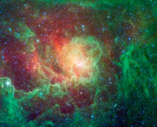 Swirling dust clouds and bright newborn stars dominate the view in this image of the Lagoon nebula from NASA's Spitzer Space Telescope. The nebula lies in the general direction of the center of our galaxy in the constellation Sagittarius.