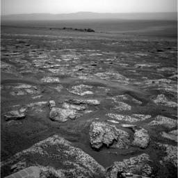 This image from the navigation camera on NASA's Mars Exploration Rover Opportunity shows the view ahead on the day before the rover reached the rim of Endeavour crater. It was taken during the 2,680th Martian day, or sol, of the rover's work on Mars.