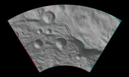 This anaglyph from NASA's Dawn spacecraft image shows the topography of asteroid Vesta's southeastern region. You need 3D glasses to view this image.