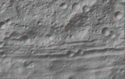 This anaglyph image shows the topography of part of Vesta's equatorial region. These craters are classed as ruin eroded craters and are most clear in the center of the image, above the troughs. You need 3D glasses to view this image.