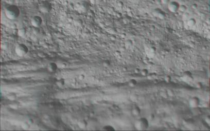 This anaglyph image shows the topography of part of Vesta's equatorial region; this uneven topography is mostly due to large, ancient, rather degraded ruin eroded craters. You need 3D glasses to view this image.