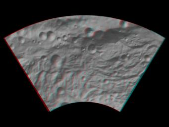 This anaglyph image shows the topography of asteroid Vesta's southwestern region. The large, heavily degraded subdued rimmed crater in the top right becomes clearer in this anaglyph image. You need 3D glasses to view this image.
