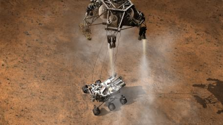 This artist's concept depicts the moment immediately after NASA's Curiosity rover touches down onto the Martian surface. The spacecraft has detected touchdown, and pyrotechnic cutters have severed connections between rover and spacecraft's descent stage.