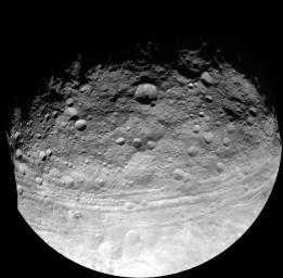 This full view of the giant asteroid Vesta was taken by NASA's Dawn spacecraft, as part of a rotation characterization sequence on July 24, 2011, at a distance of 3,200 miles and shows impact craters of various sizes and grooves parallel to the equator.