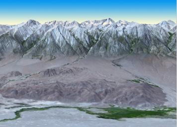At 14,505 feet high, Mt. Whitney, the highest point in the contiguous U.S., is located in California's Sierra Nevada Mountains, on the west side of Owens Valley. The Alabama Hills appear in the foreground of this image from NASA's Terra spacecraft.