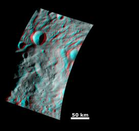 This anaglyph image from NASA's Dawn spacecraft shows the topography of the mountain-central complex in asteroid Vesta's south polar region. You need 3D glasses to view this image.