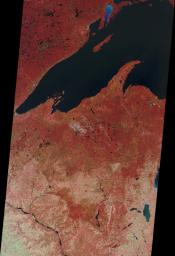 NASA's Terra satellite presents this 'false color' view of portions of Wisconsin and Michigan, including Devil's Lake, Druid Lake, Ghost Lake, Spider Lake, and Witches Lake in Wisconsin; and Bat Lake, Corpse Pond and Witch Lake in Michigan.