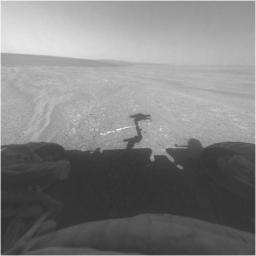 This view from the front hazard-avoidance camera on NASA's Mars Exploration Rover Opportunity shows the rover's arm's shadow falling near a bright mineral vein informally named