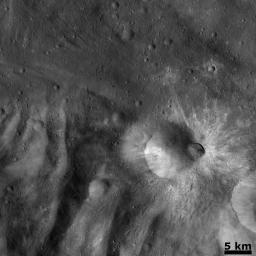 This image from NASA's Dawn spacecraft is dominated by the approximately 8 km diameter bright ray crater named Tuccia on asteroid Vesta.