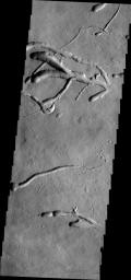 This image from NASA's 2001 Mars Odyssey spacecraft of the eastern flank of Ascraeus Mons shows multiple collapse features.