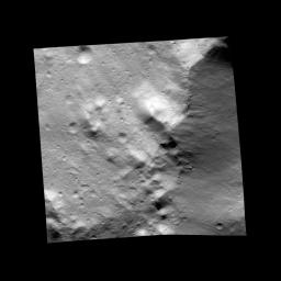 This image, one of the first obtained by NASA's Dawn spacecraft in its low altitude mapping orbit, shows an area within the Rheasilvia basin in the south polar area of the giant asteroid Vesta.