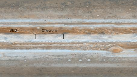 Following the path of one of Jupiter's jet streams, a line of v-shaped chevrons travels west to east just above Jupiter's Great Red Spot as seen by NASA's Cassini spacecraft.