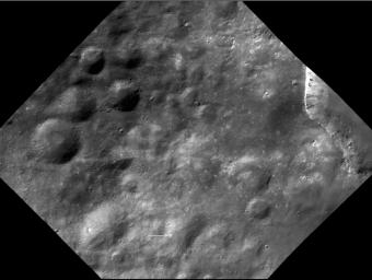 Numerous small, bright spots appear on asteroid Vesta, as seen in this image from NASA's Dawn spacecraft. This region is just north of the equator, to the west of Marcia crater.