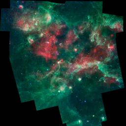 A bubbling cauldron of star birth is highlighted in this image from NASA's Spitzer Space Telescope. Massive stars have blown bubbles, or cavities, in the dust and gas -- a violent process that triggers both the death and birth of stars.