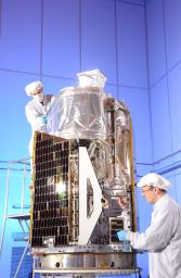 Engineers in the final stages of assembling NASA's Nuclear Spectroscopic Telescope Array, or NuSTAR, at Orbital Sciences Corporation in Dulles, Va., January 2012.