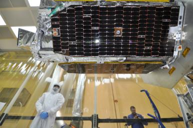 Inside an environmental enclosure at Vandenberg Air Force Base's processing facility in California, solar panels line the sides of NASA's Nuclear Spectroscopic Telescope Array (NuSTAR), which was just joined to the Orbital Sciences Pegasus XL rocket.