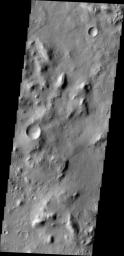 NASA's Mars Odyssey spacecraft captured this image on Feb. 19, 2012, 10 years to the day after the camera recorded its first view of Mars. This image covers an area in the Nepenthes Mensae region north of the Martian equator.