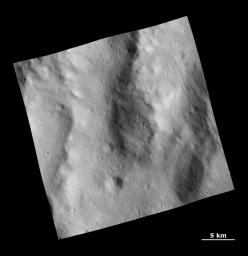 This image from NASA's Dawn spacecraft shows a rough surface covered with ejecta and fine grooves on the giant asteroid Vesta.