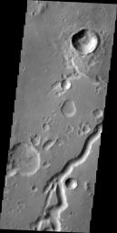This image from NASA's 2001 Mars Odyssey spacecraft shows a portion of Nanedi Valles in Xanthe Terra.