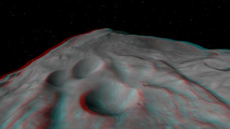 This anaglyph shows the central complex in asteroid Vesta's Rheasilvia impact basin. The central complex about two and a half times taller than Mt. Everest. You need 3-D glasses to view this image.
