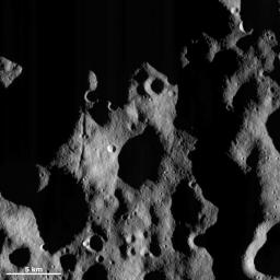 This image from NASA's Dawn spacecraft shows an area in Vesta's northern hemisphere that has been illuminated by the sun. As asteroid Vesta progresses from its winter to its spring the sunlight is creeping further and further northwards.