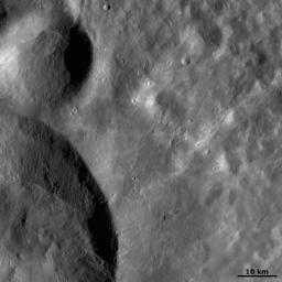 This image from NASA's Dawn spacecraft shows a close up image of two of the craters that make up the three 'Snowman' craters on asteroid Vesta.