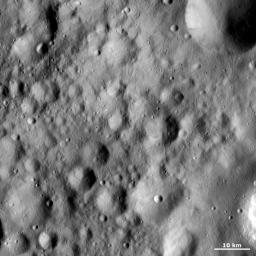 Towards the bottom of image from NASA's Dawn spacecraft ,slightly offset from the image center, is a small, young, fresh crater within a rectangular, older, heavily eroded crater.