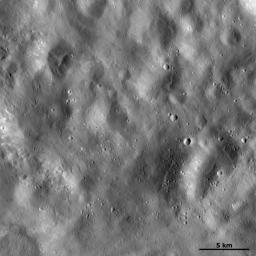 This image of asteroid Vesta from NASA's Dawn spacecraft shows a region of the surface that is rather smooth in appearance which is located in Vesta's Marcia quadrangle, near the Vestan equator.