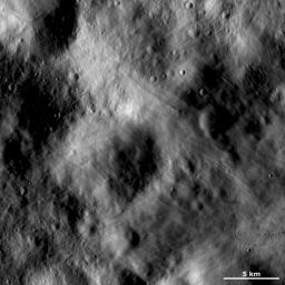 This image of asteroid Vesta from NASA's Dawn spacecraft shows an area of the surface that is both grooved and smooth, which gives it an undulating appearance. This image is located in Vesta's Numisia quadrangle, near the Vestan equator.