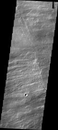 This image captured by NASA's 2001 Mars Odyssey spacecraft shows volcanic flows from Arsia Mons, the southernmost of the Tharsis volcanoes.