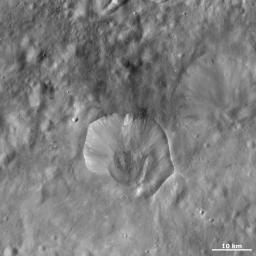 This image from NASA's Dawn spacecraft of asteroid Vesta shows Drusilla crater, which is the irregularly shaped crater offset from the center of the image.