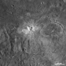 This image from NASA's Dawn spacecraft of asteroid Vesta shows Eusebia crater on the right. The smaller crater, offset from the center of the image, with a smaller crater on its rim is Tuccia crater.