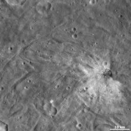 This image from NASA's Dawn spacecraft of asteroid Vesta Fabia shows Justina crater, located in Vesta's Urbinia quadrangle, in Vesta's southern hemisphere.